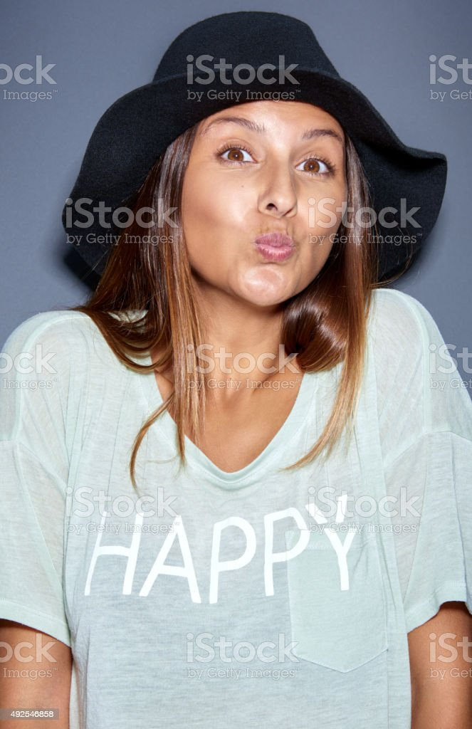 Teasing young woman asking for a kiss stock photo