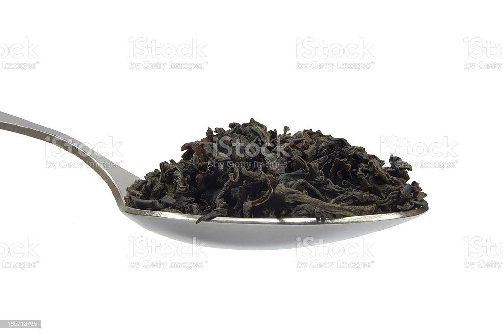 Teaspoom black tea leaf, isolated spoonful macro closeup, detailed spoon stock photo