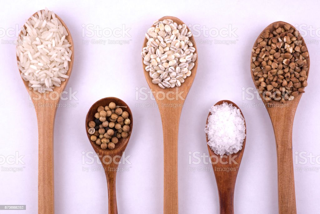 teaspoon salt, cumin, rice, pearl-barley, buckwheat, coriander stock photo