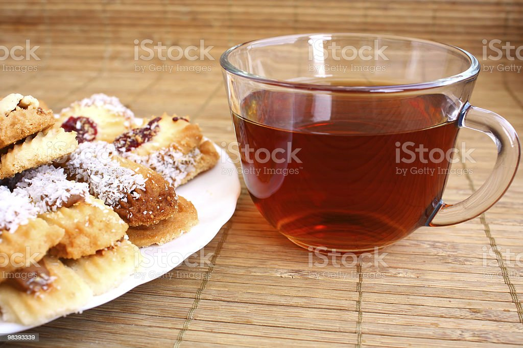 teatime: close-up cup of tea and cookies on plate royalty-free stock photo