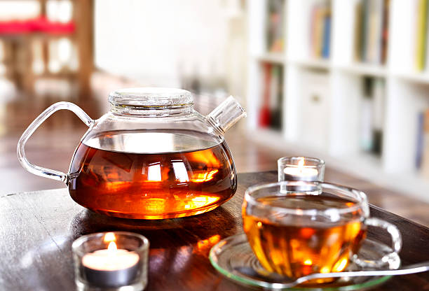 Teatime scene, cup of tea and teapot - foto stock