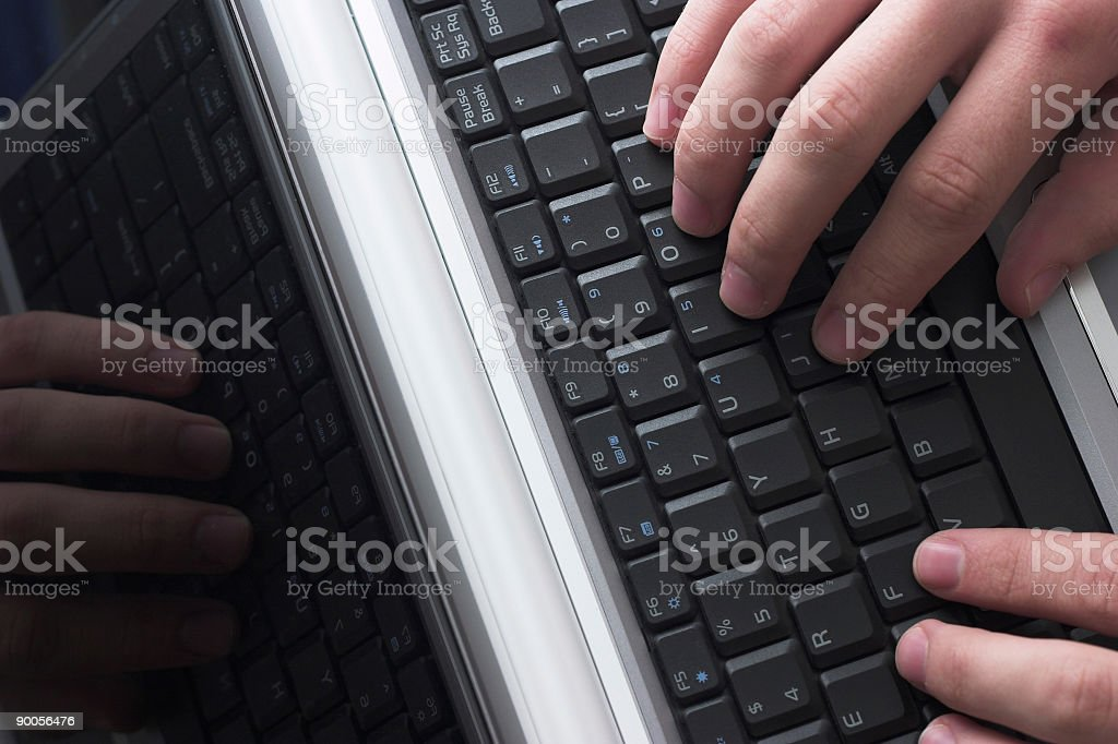 Tech - Keyboard with hands typing royalty-free stock photo