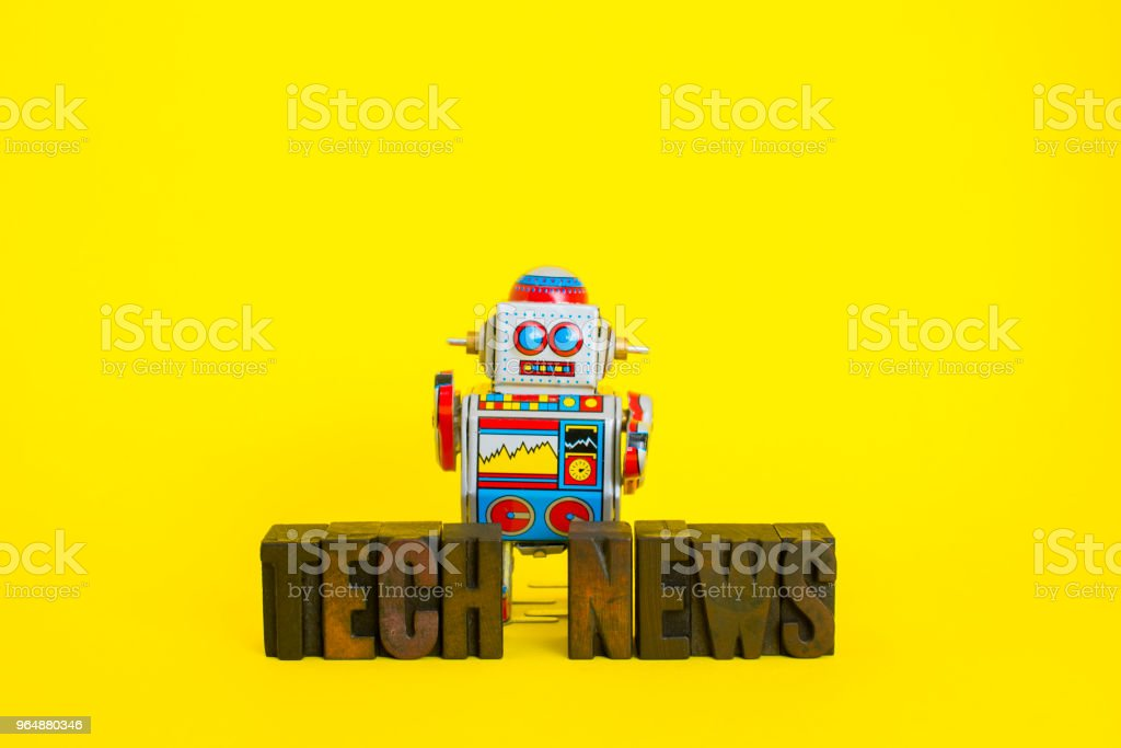 Tech News with Vintage Robot royalty-free stock photo