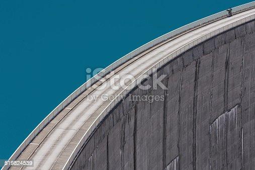 Two people standing on the dam in Kaprun,  Austria.