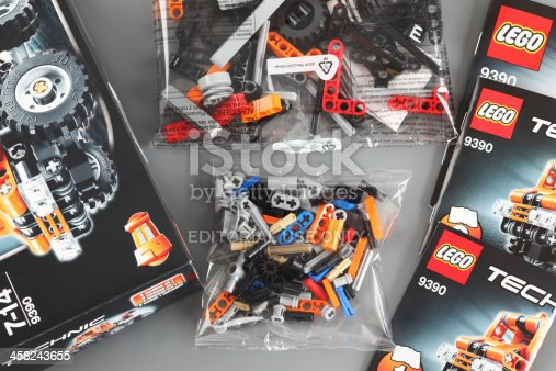 Tambov, Russian Federation - April 06, 2013: LEGO Technic set with box, instructions and details in plastic packs on grey background. Item 9390. Studio shot.