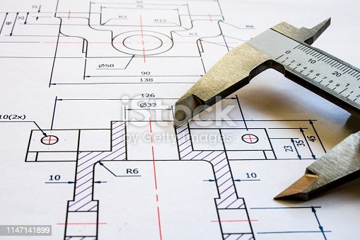 949860388istockphoto Technical drawing with calipers 1147141899