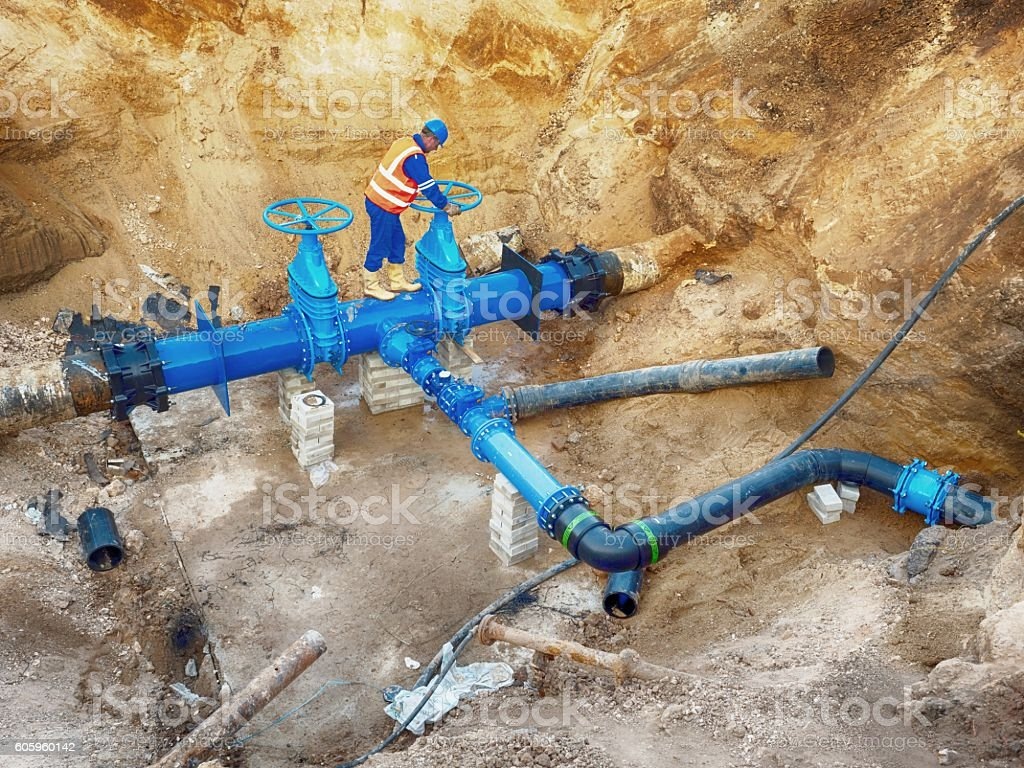 Technical open gate valve on pipes, waga multi joint members stock photo