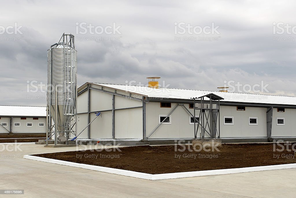 Technical room for the pigs on a cloudy day stock photo