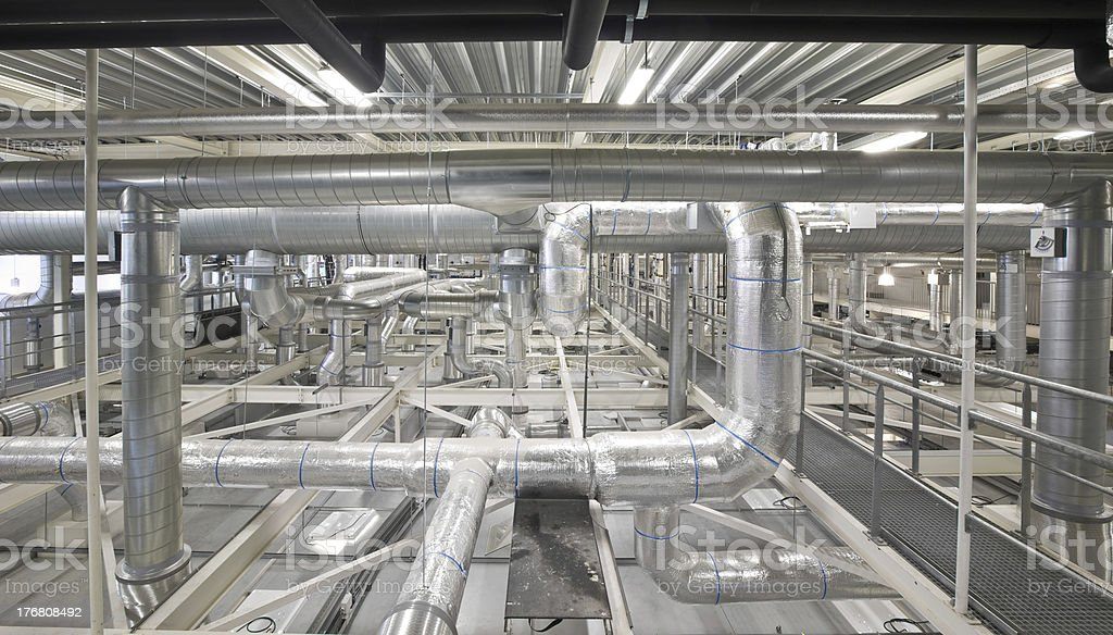 Technical space with ducts and pipes stock photo