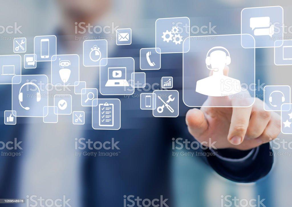 Koncepcja pomocy technicznej, osoba biznesowa dotykająca ikony helpdesk na ekranie, usługa pomocy na infolinii dostępna przez telefon, czat, e-mail lub online w celu rozwiązania incydentu za pomocą oprogramowania komputerowego, smartfona - Zbiór zdjęć royalty-free (Biznes)