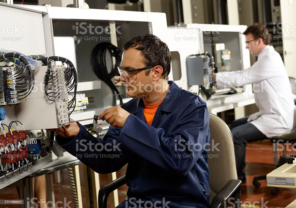 Technician and engineer. stock photo