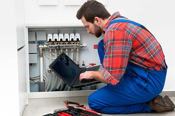 Technician at the work Technician servicing the underfloor heating pipefitter stock pictures, royalty-free photos & images