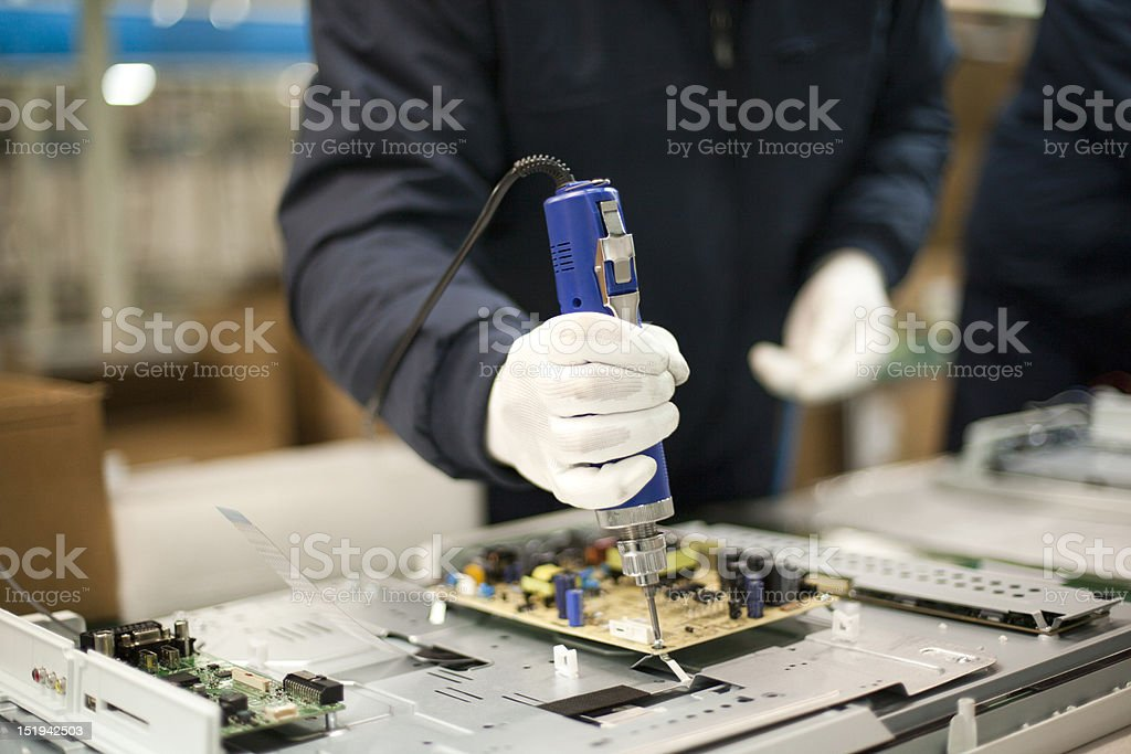 Technician at work in the factory stock photo