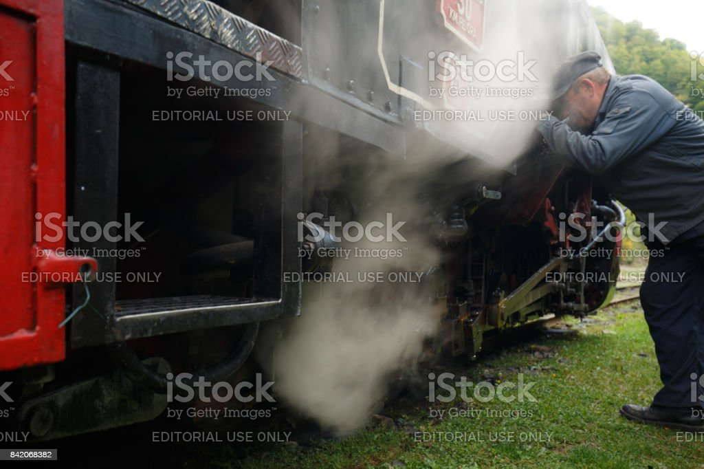 Technician Changing the Oil of an Industrial Engine stock photo