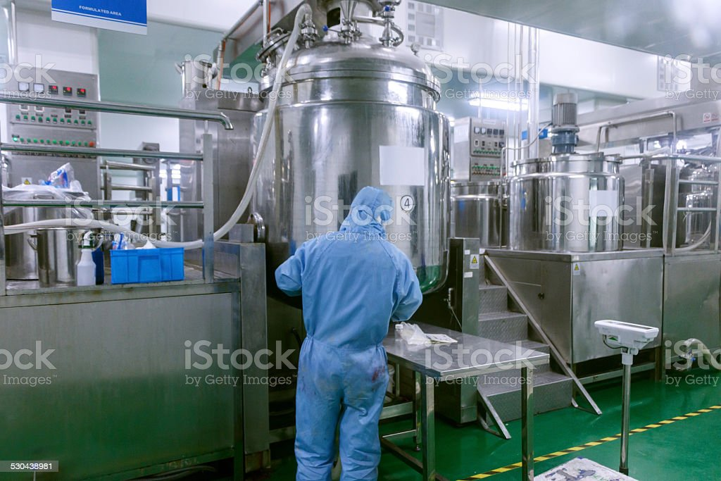 Technician check manufacture equipment and reactors in pharmacy factory stock photo