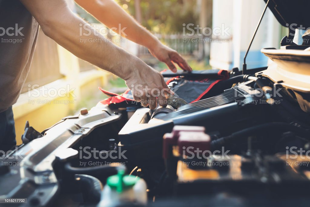 Technician check the engine daily, maintenance and repair concept stock photo