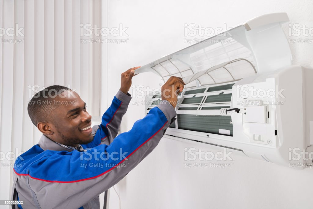 Technician Checking Air Conditioner stock photo