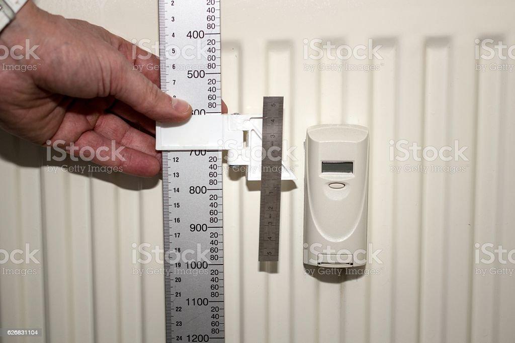 Technician checking the heat meter stock photo