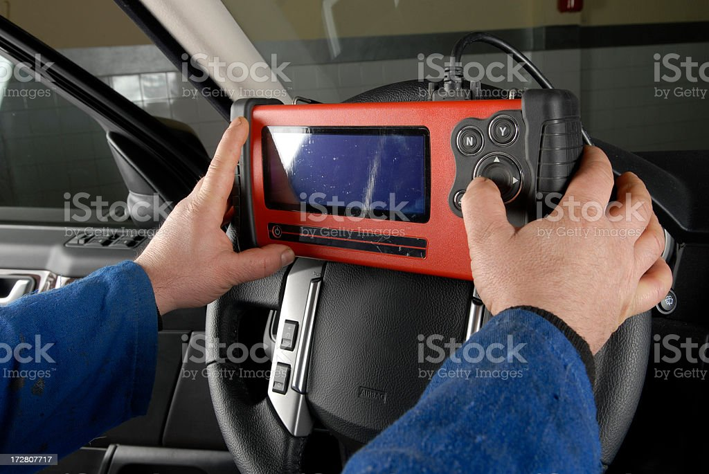 A technician detecting the cause of engine failure  royalty-free stock photo