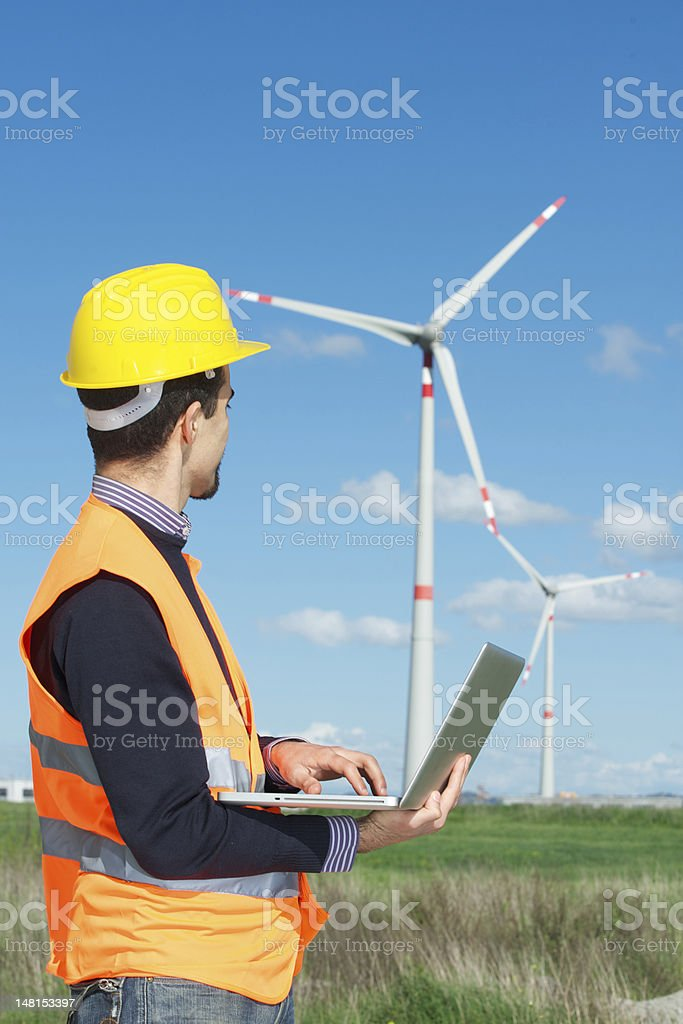 Technician Engineer in Wind Turbine Power Generator Station royalty-free stock photo