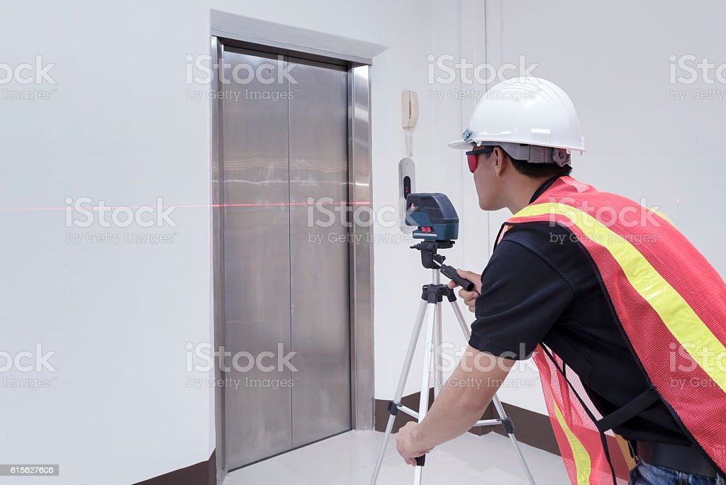Technician - Engineer investigate Laser Level and safety. Survey stock photo