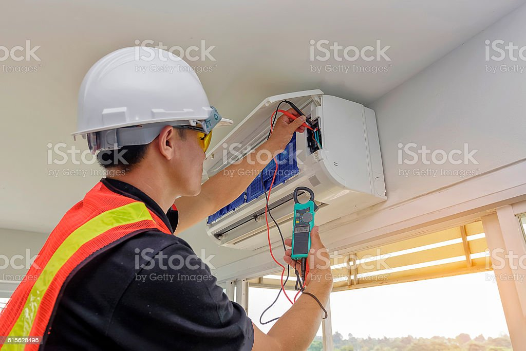 Technician - Engineer investigate Repairing Air Conditioner stock photo