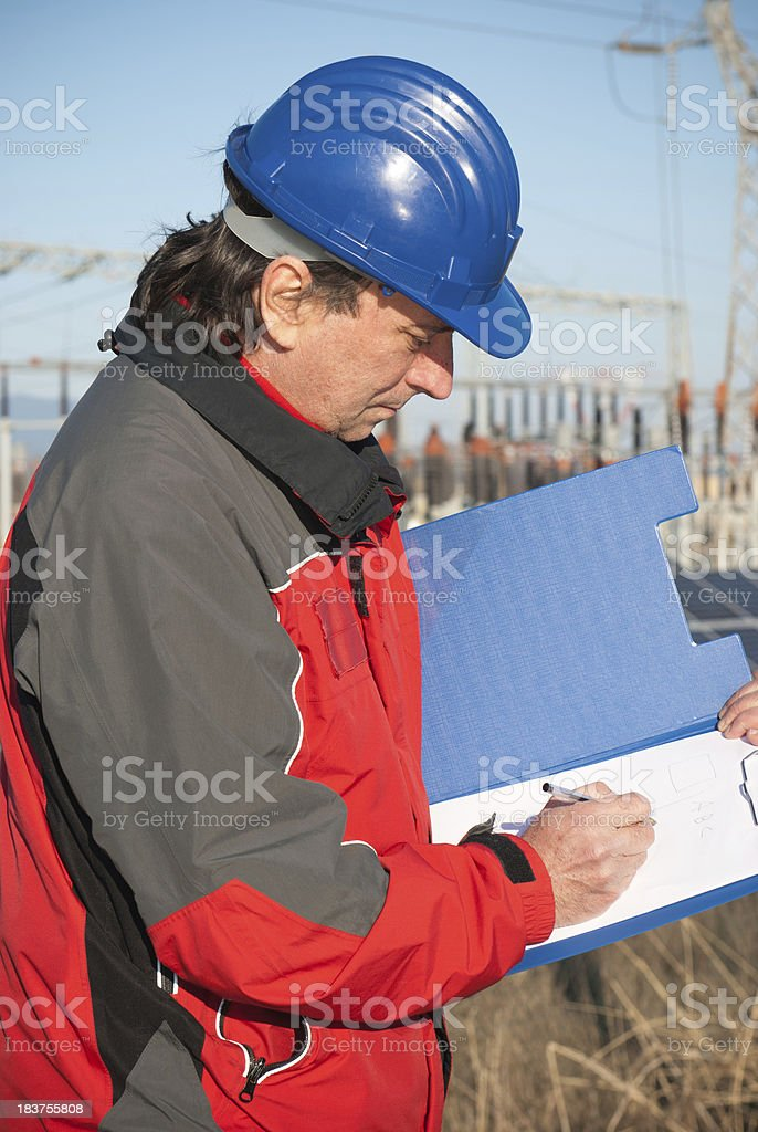 Technician engineer taking notes of solar panels royalty-free stock photo