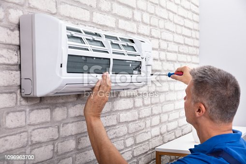 istock Technician Fixing Air Conditioner 1096963700