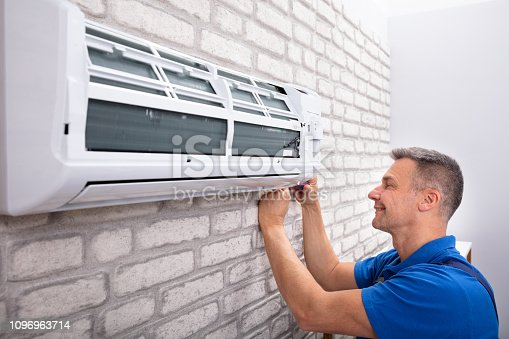 istock Technician Fixing Air Conditioner 1096963714