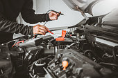 istock Technician Hands of car mechanic working in auto repair Service and Maintenance car battery 1157562440