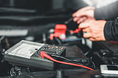 istock Technician Hands of car mechanic working in auto repair Service and Maintenance car battery 1157562441