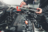 istock Technician Hands of car mechanic working in auto repair Service and Maintenance car battery 1157562454