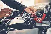 istock Technician Hands of car mechanic working in auto repair Service and Maintenance car battery 1157562595