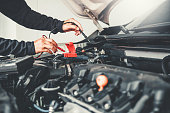 istock Technician Hands of car mechanic working in auto repair Service and Maintenance car battery 1160326626