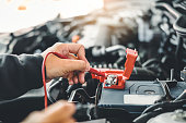 istock Technician Hands of car mechanic working in auto repair Service and Maintenance car battery 1163096987