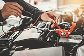 istock Technician Hands of car mechanic working in auto repair Service and Maintenance car battery 1163096988
