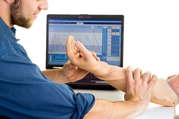 technician helps man with prosthetic arm. - protesutrustning bildbanksfoton och bilder