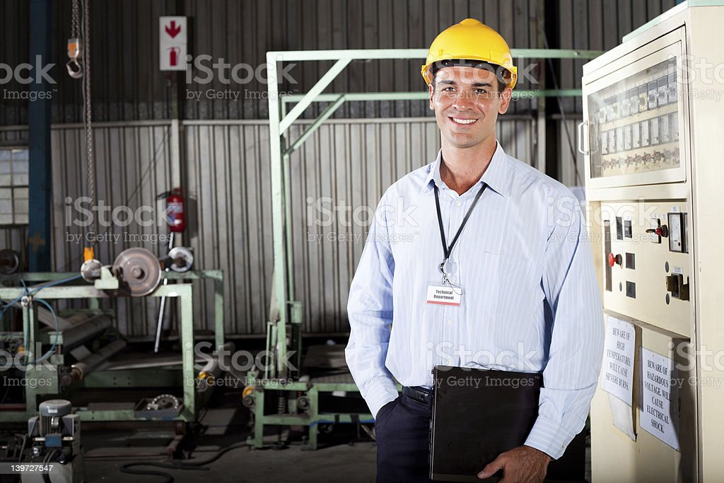 technician in factory royalty-free stock photo