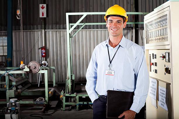 technician in factory stock photo