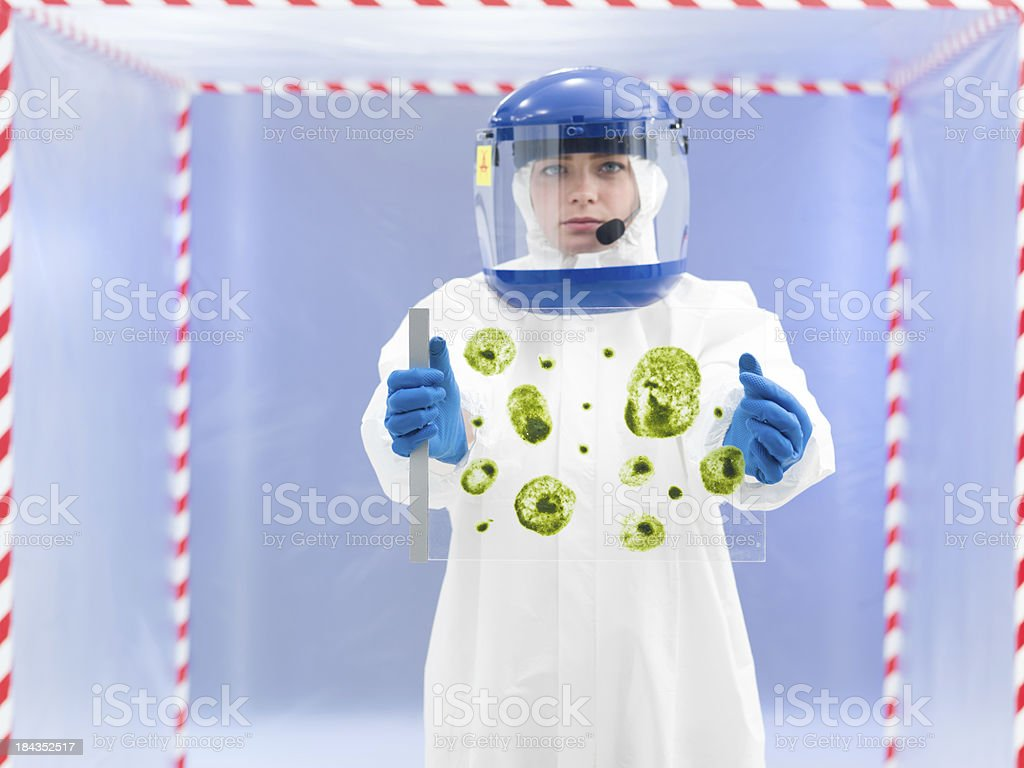 technician in protective suit holding biological sample royalty-free stock photo