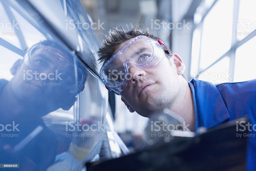 Technician inspecting car stock photo