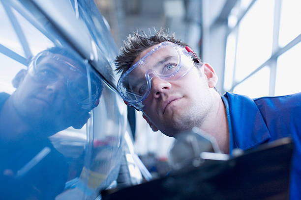 technician inspecting car - quality control stock photos and pictures
