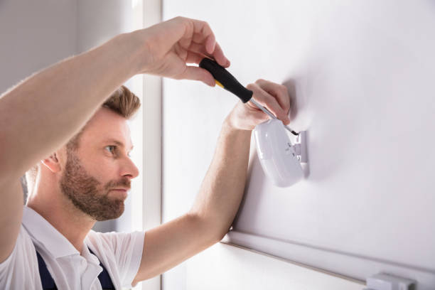 Technician Installing Security System Door Sensor Young Male Technician Installing Security System Door Sensor With Screwdriver sensor stock pictures, royalty-free photos & images