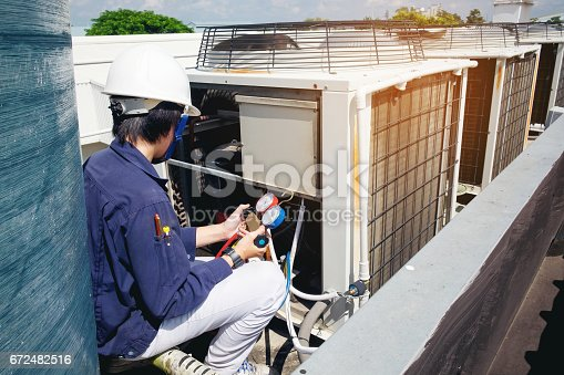 istock Technician is checking air conditioner 672482516