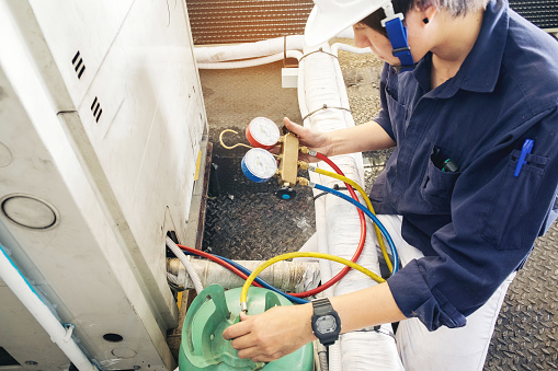 istock Technician is checking air conditioner 681062522