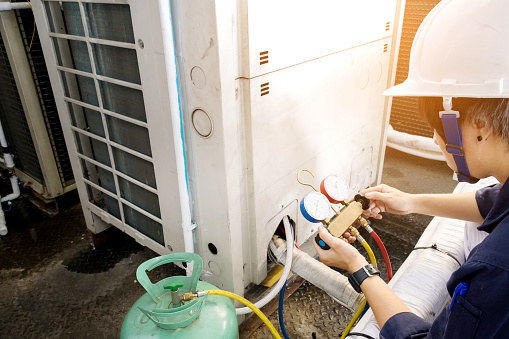 istock Technician is checking air conditioner 681062708