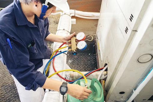 istock Technician is checking air conditioner 681083818