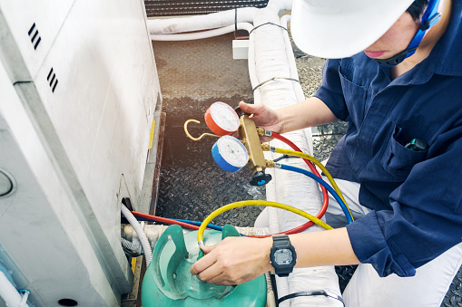 istock Technician is checking air conditioner 681828526