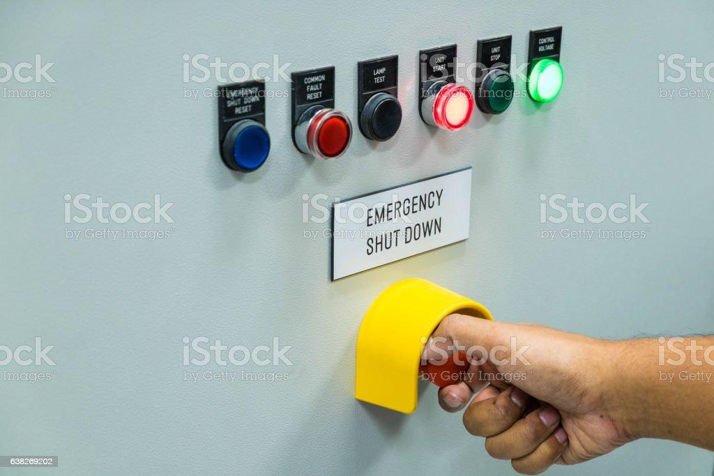 Technician is turning off emergency shutdown button stock photo