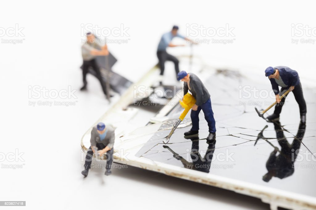 Technician miniature fixing, repair and maintenance crack screen mobile phone or smartphone which fall of the floor makes the screen glass broken stock photo